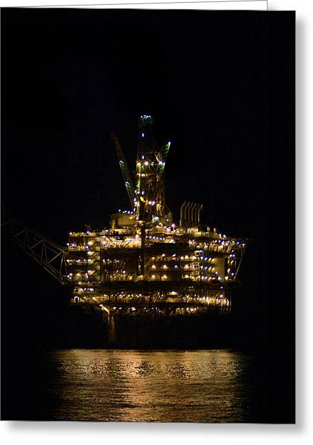 Gold Industry And Production Greeting Cards - Oil production platform at night Greeting Card by Bradford Martin