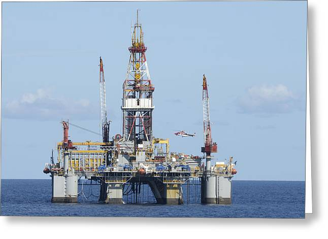 Sea Platform Greeting Cards - Oil rig and helicopter Greeting Card by Bradford Martin