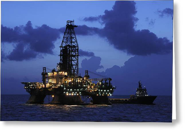 Sea Platform Greeting Cards - Oil Rig and Vessel at Night Greeting Card by Bradford Martin
