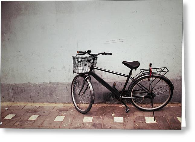 Wheel Pyrography Greeting Cards - Old Bicycle against a Wall Greeting Card by Thanapol Kuptanisakorn