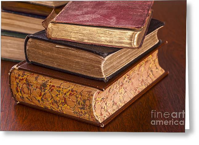 Scholarship Greeting Cards - Old Books on Dark Wood Background Greeting Card by Colin and Linda McKie