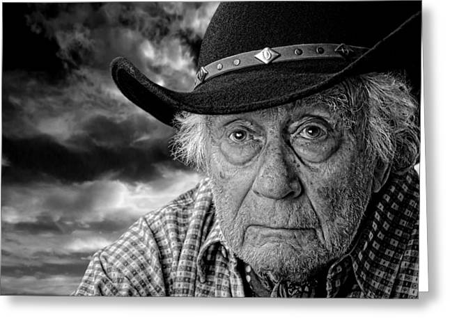 Gray Hair Greeting Cards - Old Cowboy Against A Stormy Sky Greeting Card by Kim M Smith