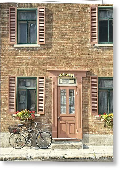 Townhouses Greeting Cards - Old downtown building doorway and bike on street Greeting Card by Edward Fielding