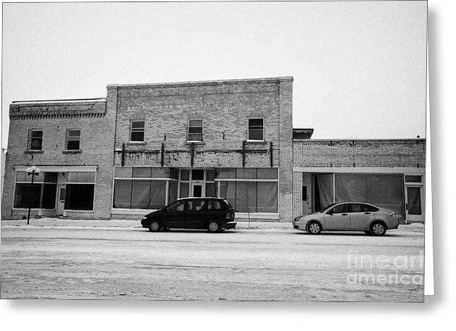Wintry Greeting Cards - old empty stores brick historic buildings 3rd ave Kamsack Saskatchewan Canada Greeting Card by Joe Fox
