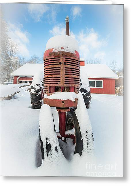 Old Farm Tractor In The Snow Greeting Card by Edward Fielding