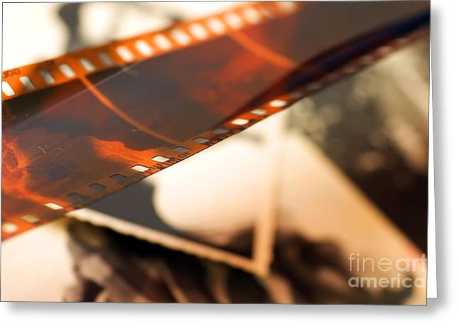 Filmstrip Greeting Cards - Old film strip and photos background Greeting Card by Michal Bednarek