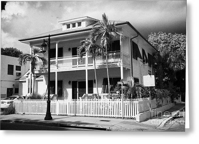 old historic wooden two storey building with white picket fence key west florida usa Greeting Card by Joe Fox
