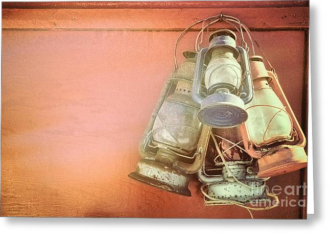 Glass Wall Greeting Cards - Old kerosene lanterns Greeting Card by Jane Rix