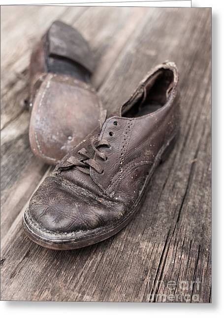 Lace Shoes Greeting Cards - Old leather shoes on wooden floor Greeting Card by Edward Fielding