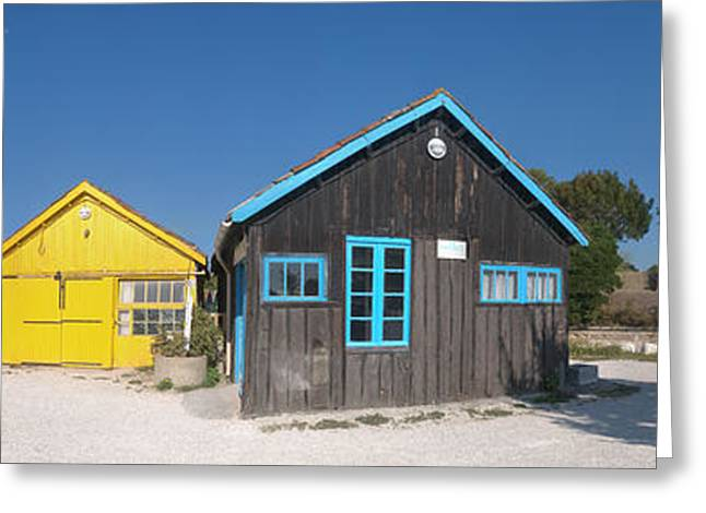 Chateau Greeting Cards - Old Oyster Farmers Shacks, Le Chateau Greeting Card by Panoramic Images