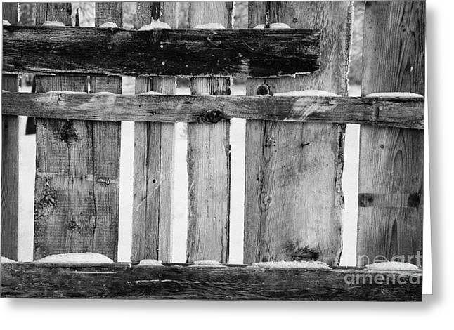 old patched up wooden fence using old bits of wood in snow Forget Greeting Card by Joe Fox