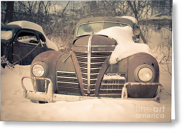 White Photographs Greeting Cards - Old Plymouth classic car in the snow Greeting Card by Edward Fielding