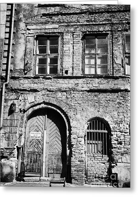 Old Jewish Area Greeting Cards - Old Red Brick Crumbling Building In Kazimierz District With Plaster Facade Removed To Expose Brickwork Krakow Greeting Card by Joe Fox