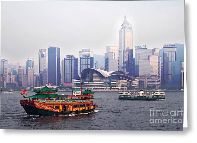 Hongkong Greeting Cards - Old traditional chinese junk in front of Hong Kong Skyline Greeting Card by Lars Ruecker