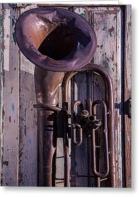 Tuba Greeting Cards - Old tuba on worn door Greeting Card by Garry Gay