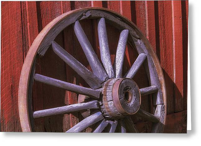 Wagon Wheels Photographs Greeting Cards - Old Wagon Wheel Leaning Against Barn Greeting Card by Garry Gay