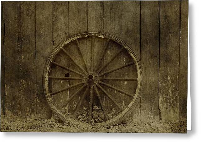 Old Wagon Wheel On Barn Wall Greeting Card by Dan Sproul
