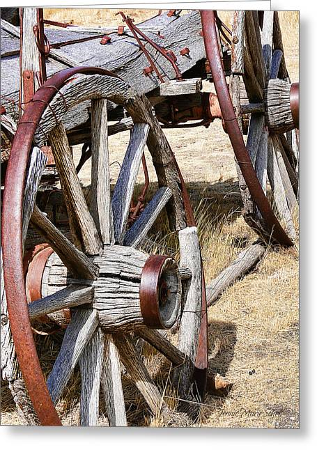 Wooden Wagons Greeting Cards - Old Wagon Wheels from Montana Greeting Card by Jennie Marie Schell