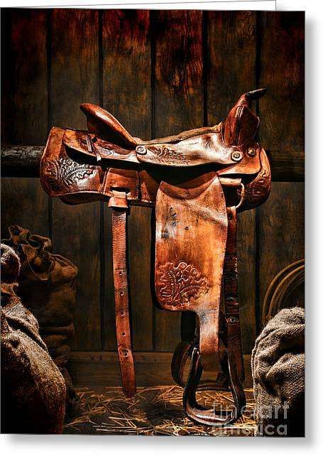 Folklore Greeting Cards - Old Western Saddle Greeting Card by Olivier Le Queinec