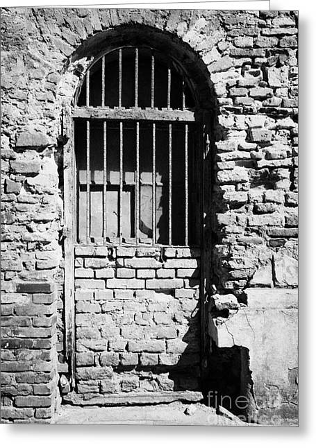 Old Jewish Area Greeting Cards - Old Wooden Framed Window With Weathered Steel Bars Door Replacement In Red Brick Building With Plaster Removed Krakow Greeting Card by Joe Fox