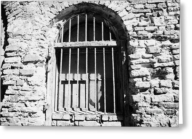 Polish City Greeting Cards - Old Wooden Framed Window With Weathered Steel Bars In Red Brick Building With Plaster Removed Krakow Greeting Card by Joe Fox
