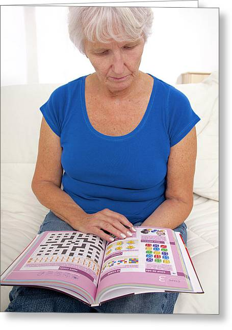 Older Lady Reading Puzzle Book Greeting Card by Lea Paterson