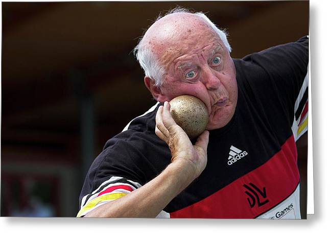 Older Man About To Throw Shot Put Greeting Card by Alex Rotas
