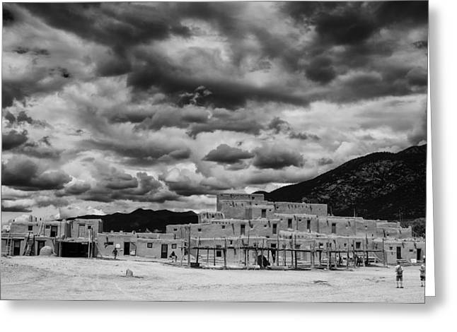 Taos Photographs Greeting Cards - Ominous Clouds over Taos Pueblo Greeting Card by Silvio Ligutti