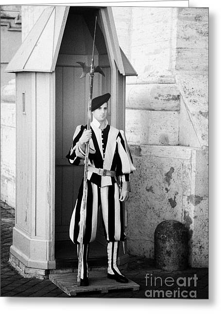 Swiss Guard Greeting Cards - One of the Papal Swiss Guard stands guard in traditional uniform with pike in Vatican City Rome Lazio Italy Greeting Card by Joe Fox