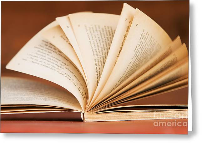 Article Greeting Cards - Open book in retro style Greeting Card by Michal Bednarek
