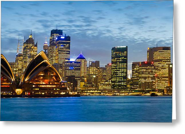 Music Photography Greeting Cards - Opera House And Buildings Lit Greeting Card by Panoramic Images