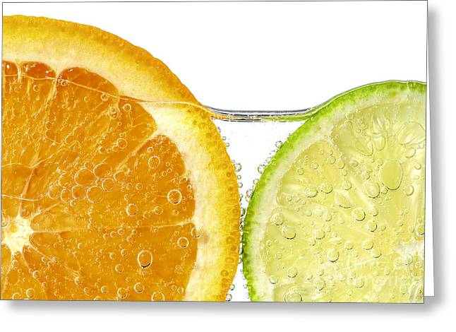 White Photographs Greeting Cards - Orange and lime slices in water Greeting Card by Elena Elisseeva