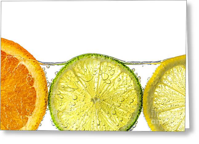 Fruits Photographs Greeting Cards - Orange lemon and lime slices in water Greeting Card by Elena Elisseeva