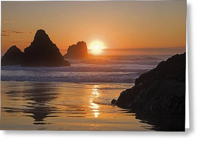 Orange Sunset Behind Offshore Rocks Greeting Card by Philippe Widling
