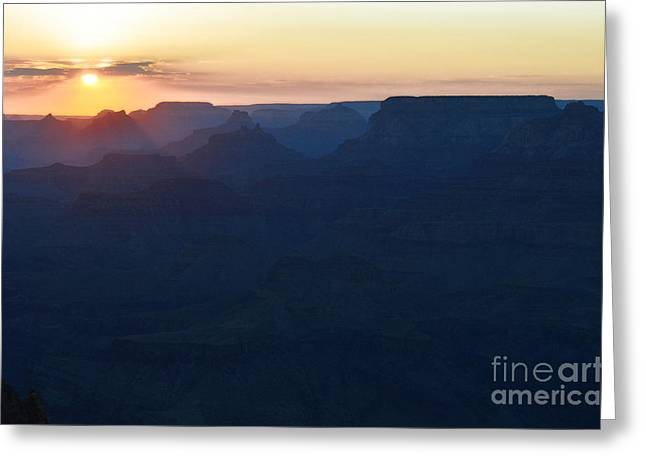 Scenic Landscape Greeting Cards - Orange Twilight Sunset over Silhouetted Spires in Grand Canyon National Park Diffuse Glow Greeting Card by Shawn O
