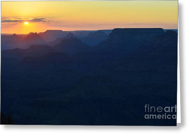Grand Canyon Greeting Cards - Orange Twilight Sunset over Silhouetted Spires in Grand Canyon National Park Greeting Card by Shawn O