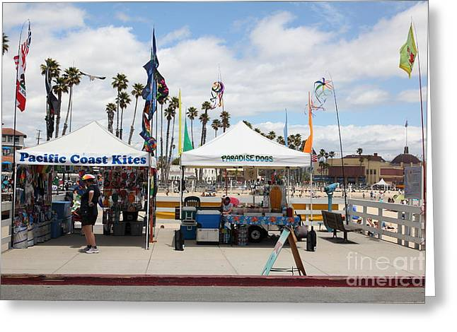 Santa Cruz Ca Photographs Greeting Cards - Pacific Coast Kites and Paradise Dogs On The Municipal Wharf At The Santa Cruz Beach Boardwalk Calif Greeting Card by Wingsdomain Art and Photography