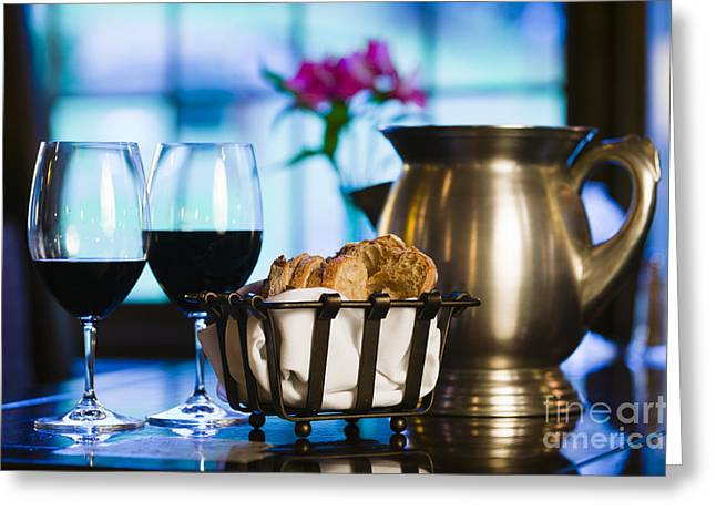 Old Pitcher Greeting Cards - Pair of wine glasses and sliced bread in a restaurant setting. Greeting Card by Don Landwehrle