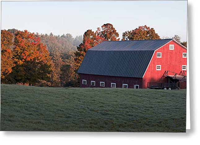 Foliage Photographs Greeting Cards - Panoramic view of a red barn at sunrise Greeting Card by Edward Fielding