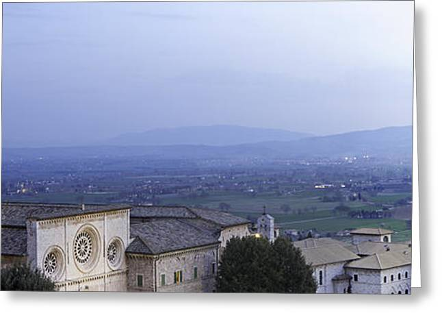 Night Scenes Greeting Cards - Panoramic View of Assisi at Night Greeting Card by Susan  Schmitz