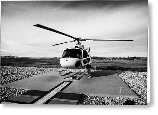 Helipad Greeting Cards - papillon helicopter tours on helipad with ground crew member at Grand canyon west airport Arizona US Greeting Card by Joe Fox