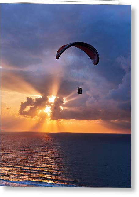 Sunset.sky Greeting Cards - Paragliding At Sunset On Sea With Sun Beams Greeting Card by Mikel Martinez de Osaba