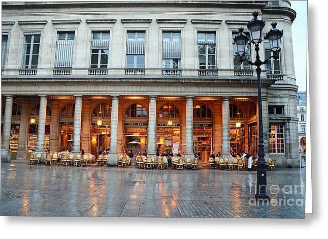Rainy Night Greeting Cards - Paris Cafe Le Nemours - Famous Paris Cafe at Place Collette - Cafe Le Nemours Photography Greeting Card by Kathy Fornal