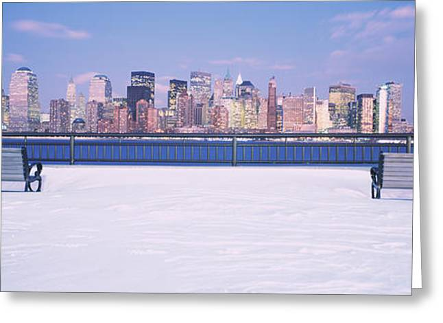 Snow New York City Greeting Cards - Park Benches In Snow With A City Greeting Card by Panoramic Images