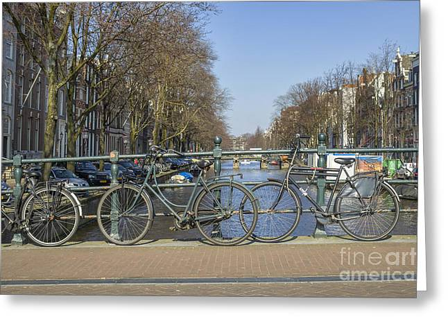 Parked Bikes On A Bridge In Amsterdam Greeting Card by Patricia Hofmeester