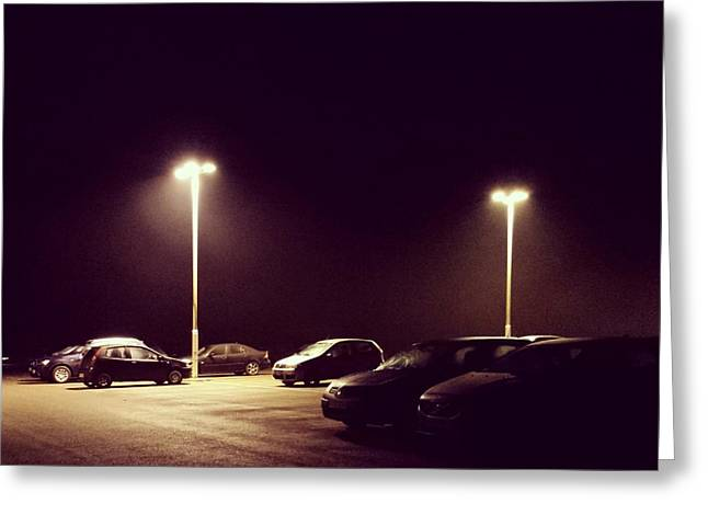 Night Lamp Greeting Cards - Parked cars in a car park Greeting Card by Project B