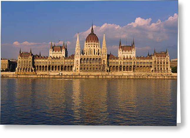 Danube Greeting Cards - Parliament Building At The Waterfront Greeting Card by Panoramic Images