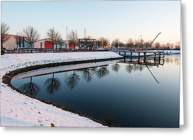 Snowy Evening Greeting Cards - Part of a small port in low sunlight Greeting Card by Ruud Morijn