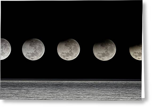 Partial Lunar Eclipse Greeting Card by Luis Argerich