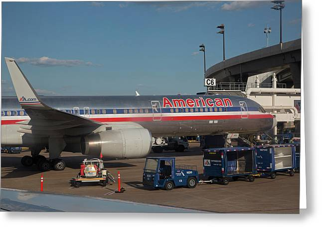 Passenger Airliner At An Airport Greeting Card by Jim West